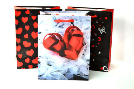 gift bags: valentine gift bags isolated on white background close up