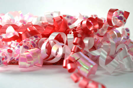 curly celebratory ribbon isolated on white close up Stock Photo