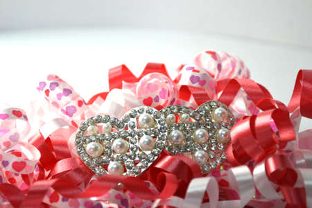 curly celebratory ribbon with heart hairclip on white close up
