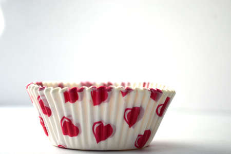 heart paper cupcake container isolated on white background close up Stock Photo