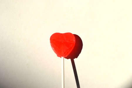 heart lollipop isolated on white background close up