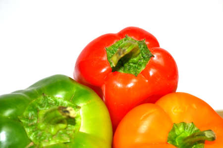 red orange and green peppers isolated on white background