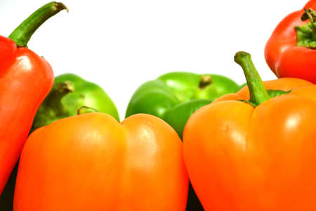 red orange, and green peppers isolated on white background close up Stock Photo