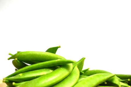 fresh green snap peas isolated on white background close up