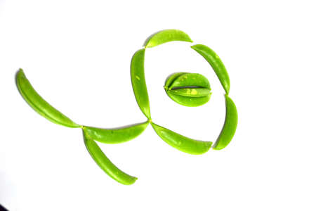 snap peas in shape flower isolated on white background Stock Photo