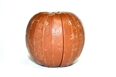 chocolate orange isolated on white background close up