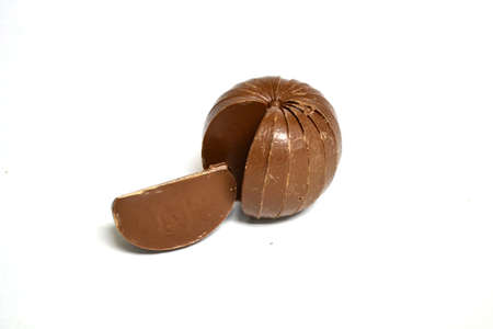 slice of chocolate from a chocolate sphere isolated on white background Stock Photo