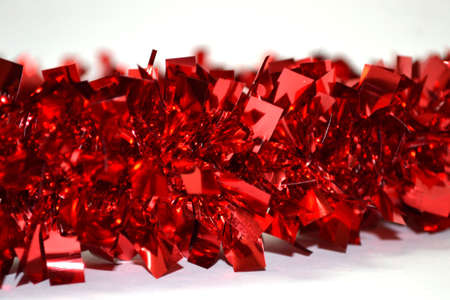 shiny background: shiny red garland isolated on white background close up