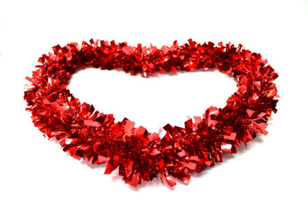 red garland in heart shape isolated on white background close up Stock Photo
