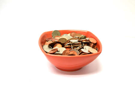 red bowl of coins isolated on white background Stock Photo
