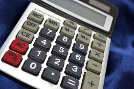 calculator on blue satin close up