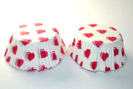 upside down heart paper cupcake containers isolated on white background close up