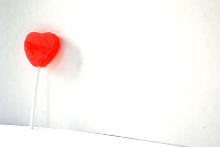red heart lollipop isolated on white background