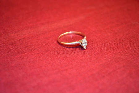 jewellery isolated on red background close up Stock Photo