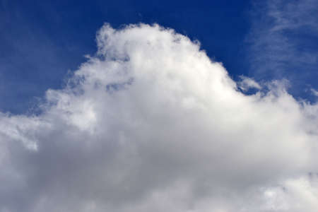 blue sky with large fluffy white cloud Stock Photo