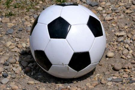 Soccer ball isolated on gravel Stock Photo