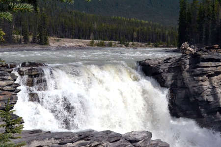 Waterfall located along the Athabasca River in Jasper National Park in Alberta, Canada Stock Photo
