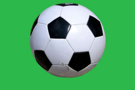 Soccer ball isolated on green background