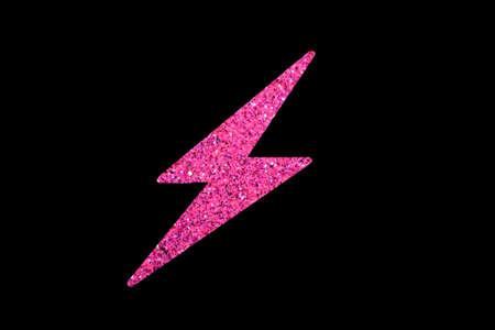Pink glitter lightning bolt isolated on black background