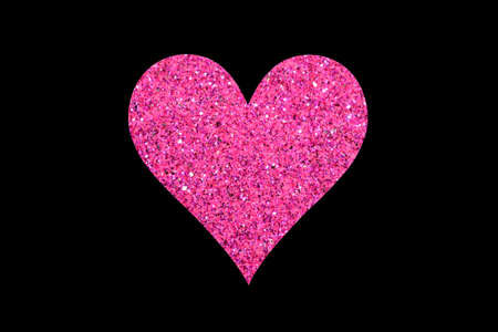 Pink glitter heart isolated on black background Stock Photo