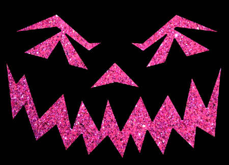 Pink glitter jack o lantern face isolated on black background Stock Photo