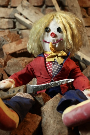 Scary doll with big knife photo