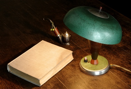 Old lamp, book and pipe photo