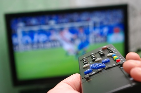Football match and remote control photo