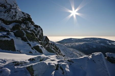 Winter view with rocks and sun photo