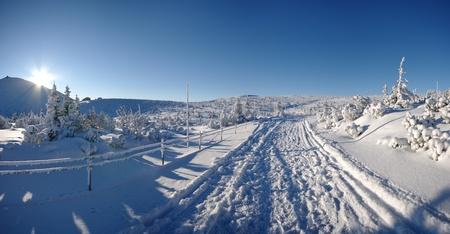 Snowy road near Sniezka mountain (Karpaty) Stock Photo - 8591694
