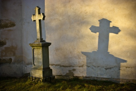 gravestones: Lonely grave in rays of sunshine