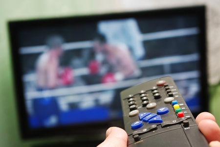 Boxing fight and remote control Stock Photo