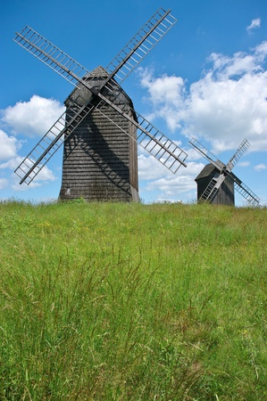 Two windmills during the summer photo