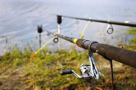 signalling device: Two fishing rods on the coast of lake Stock Photo