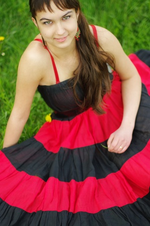 Gypsy girl in red dress photo