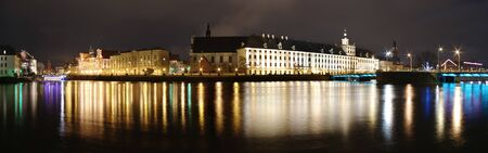 Night panorama with buildings and river photo