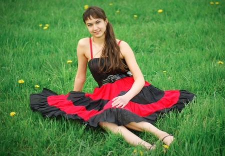 Girl in red dress on the grass photo