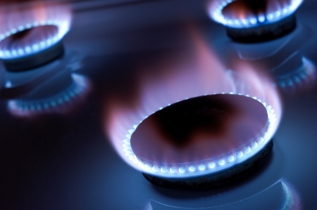 Gas burner in the kitchen oven photo
