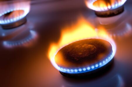 Gas burner with yellow flame in the kitchen oven