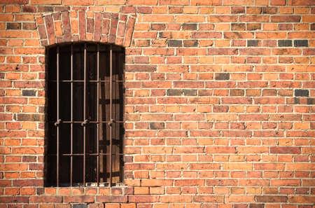 iron bars: Old brick wall with window and iron bars