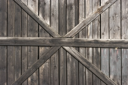 Old wooden door with big cross for background Stock Photo