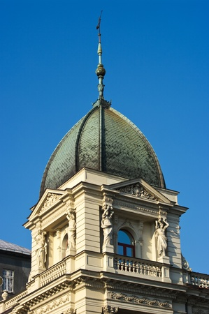Old tenement house tower with sculptures photo