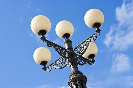 Old stylized street lantern and blue sky Stock Photo - 9316256