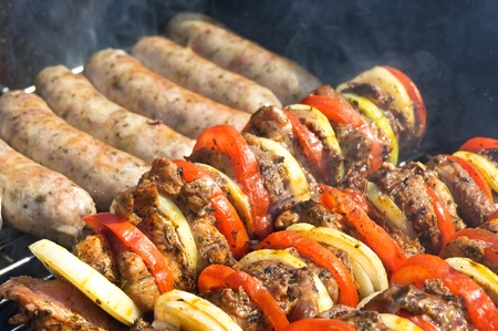 Shashlik and white sausage on the grill Stock Photo