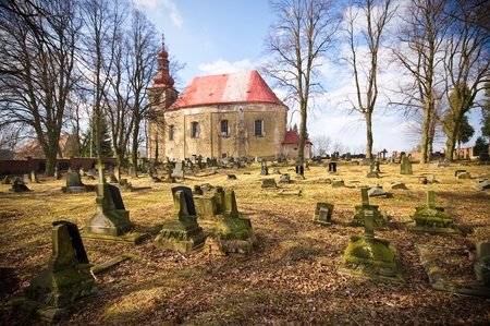 Cemetery scene with lot of graves and church Stock Photo - 9316316
