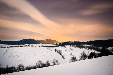 Winter night scene in hills with beautiful sky photo