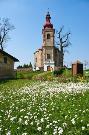 Church and fresh flowered madow photo