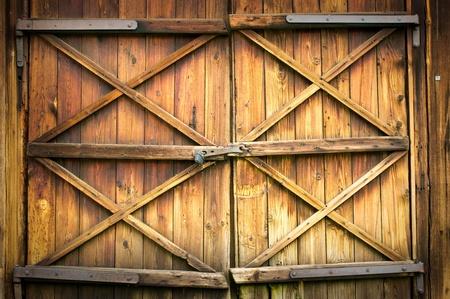 Wooden door with four crosses Stockfoto