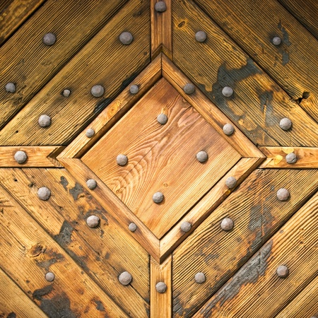 Abstract wooden texture with hobnails photo