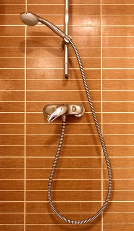 Shower on the brown wall